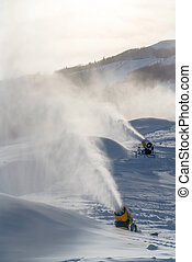 Snow cannons against mountain and sky in Utah. Snow cannons...