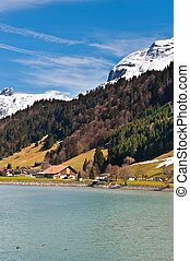 Snow-capped Alps - Lake on the Background of Snow-capped...