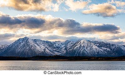 Snow capped mountain range of Grand Teton at sunrise.