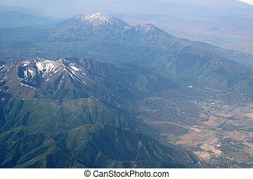 snow capped mountains - Mountains with green trees and a ...