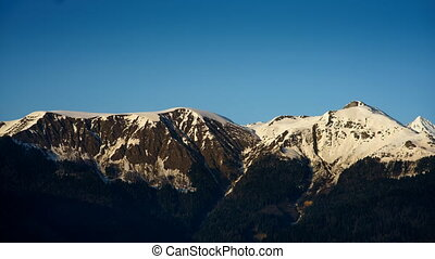 snow-capped peaks in the setting sun