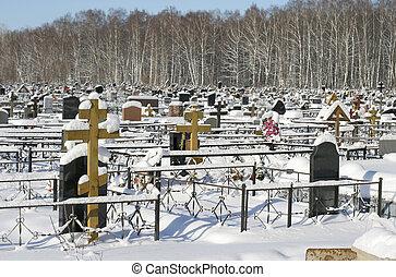 snow-clad graveyard in winter