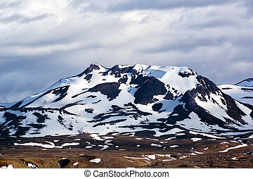 Snow clad mountains in summer.