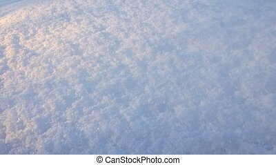 Snow closeup with sunset light. Slider