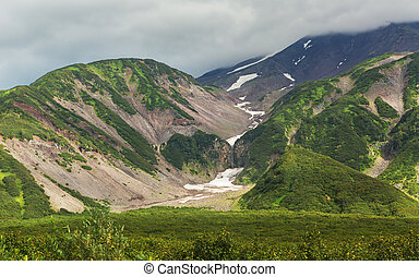 Snow cover on mountains of Vilyuchinsky pass in the summer.