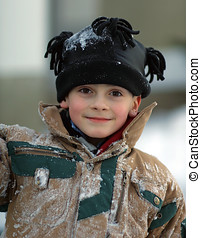 Snow Covered Boy - Young boy enjoying the outdoors. Covered...