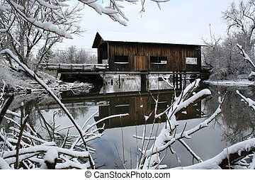 Snow covered bridge. - Snow covered old covered wooden...