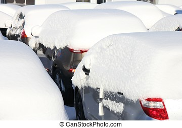snow covered cars