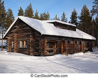 Snow-covered chalet - Snow-covered log cabin in a holiday...
