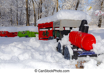 Snow covered Christmas train in a forest
