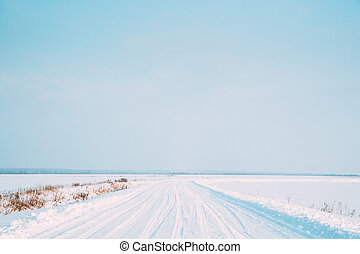 Snow-covered Countryside Road In Winter Sunny Day