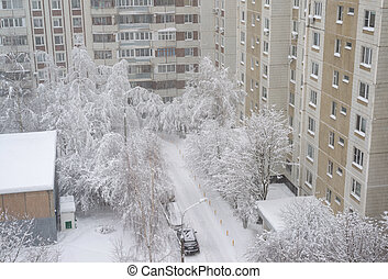 Snow-covered courtyard of multi-storey residential building in Moscow, Russia