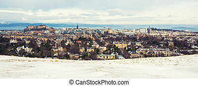 Snow covered Edinburgh panorama, including castle and Arthurs seat