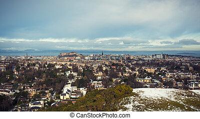 Snow covered Edinburgh panorama, including castle and firth of forth