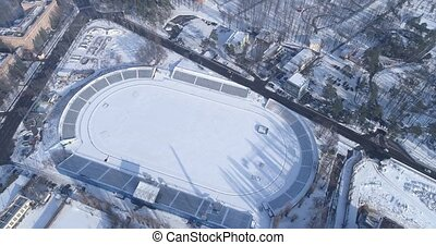 Snow-covered football field - Aerial view of the...