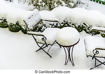 snow-covered garden furniture, symbol of winter, winter...
