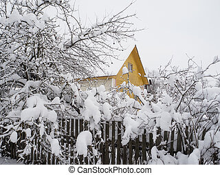Snow-covered houses. A lot of snow in the winter