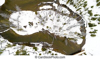 Snow covered island in Redfish Creek winter Idaho wilderness