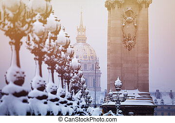 Snow-covered lanterns on Pont Alexandre III, Paris