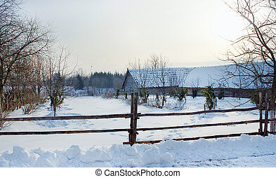 Snow - covered manor - Snow-covered manor house, fence in...