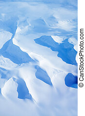 Snow Covered Mountains - An aerial shot of snow covered...