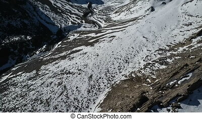Snow covered mountains and snowy valley. - Low Angle....