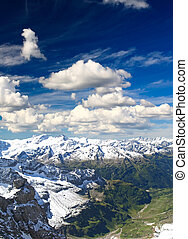snow covered mountains at summer time in Swizerland