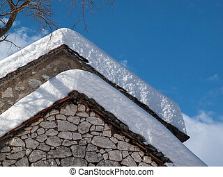 Snow covered old house
