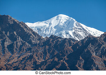 Snow Covered Peaks and Rugged Terrain - The beautiful rugged...