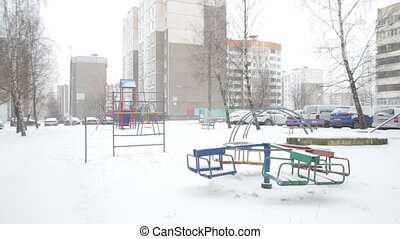 Snow-covered playground in the city, winter, blizzard