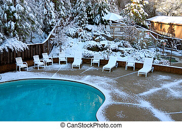 Snow Covered Pool - A swimming pool with a snowy mountain in...