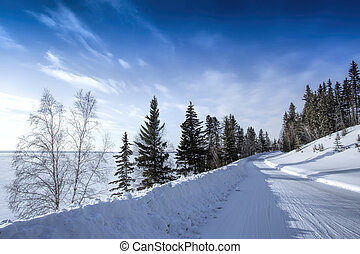 Snow Covered Road - A snow covered winter road in Northern...