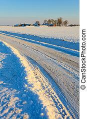 Snow covered road in winterlandscape