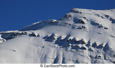 Snow covered rock layers. Mount Mittaghorn.