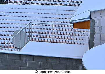 Snow-covered roof and satellite
