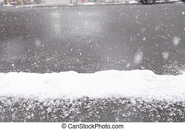 Snow covered sidewalk in Sapporo city