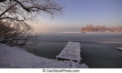 Snow-covered view of the river