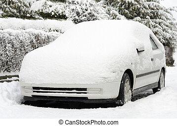 Snow-covered white car