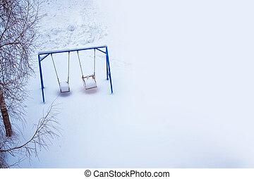 Snow covered winter playground.