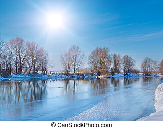 snow-covered winter river in sunny day