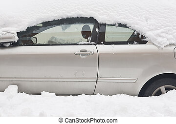 Snow covering car. Parked vehicle trapped by snowstorm. Transport problems