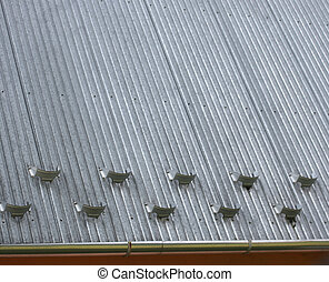 Snow cutters on the roof of the house. Roof Snow Retention.