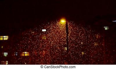 Snow drift under street lamp poles