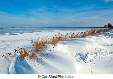snow dunes at a lake in Winter (Marken The Netherlands)