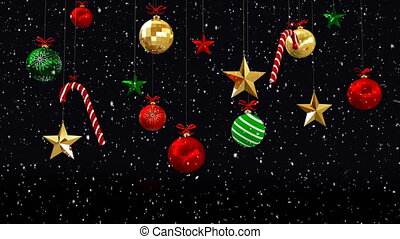 Animation of snow falling and Christmas decorations with baubles and sugar canes on black background