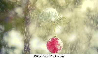 Snow falling on christmas decoration ball slowmotion