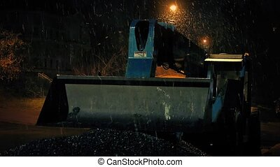 Snow Falling On Digger Machine - Large digger on building...
