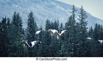 Snow Falling On Houses In Forest