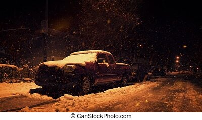 Snow Falling On Truck At Night - Pickup truck covered in...