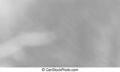 snow falls on a blurred background.
